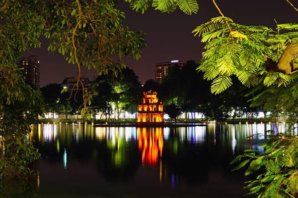 Hanoi by night. Turtle Tower reflecting in Hoan Kiem Lake