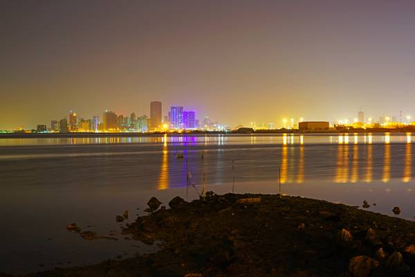 Bahrain by night. Reflections in the gulf